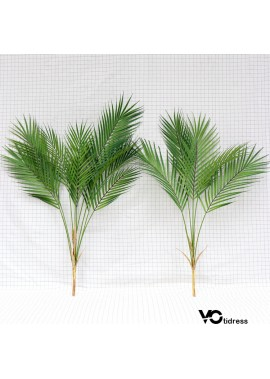 Two Fake Flowers Simulating Plants Scattered Leaves